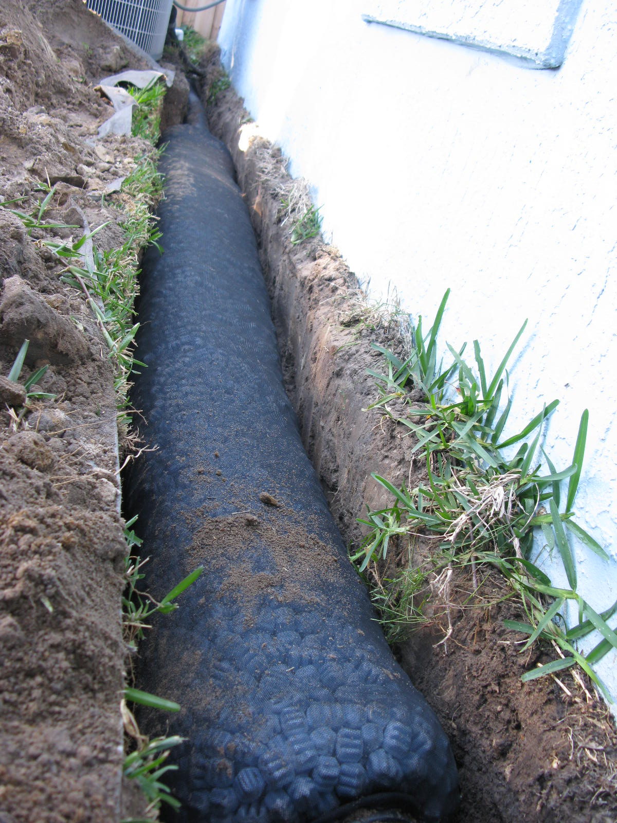 French drain pipe protect your basement or crawl space for Basement curtain drain